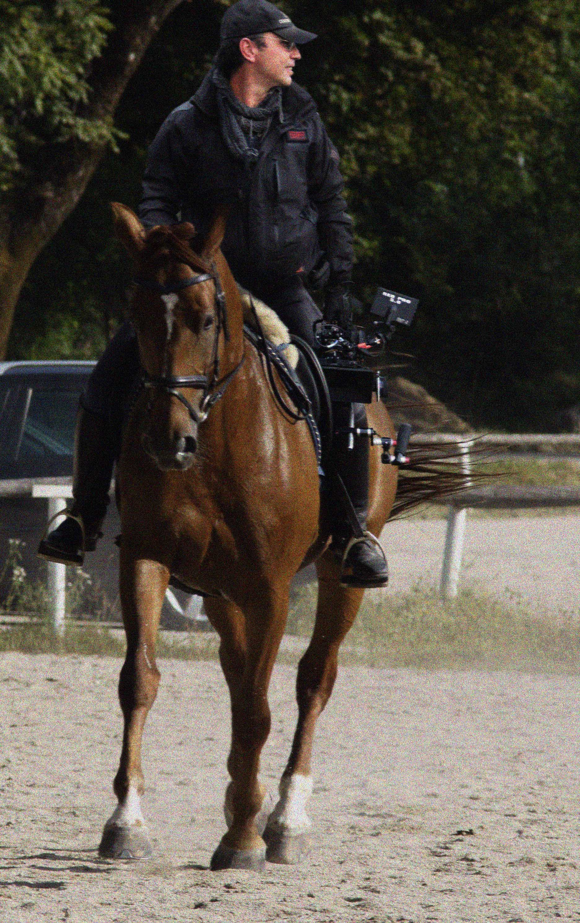 Filming handheld off horse