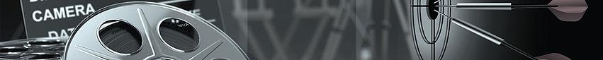 """Das Bild zeigt die Nahaufnahme einer Filmrolle und Dartpfeile, die in einer Darscheibe in der Mitte stecken. Das Textfeld in der Mitte des Bildes hat die Aufschrift """"Strategie"""""""