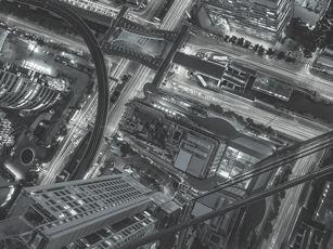 """Link-Bild zur Seite """"TOP Listen des IT-Unternehmens TECXIPIO. Auf dem Bild erkennt man die Aussicht von einem Wolkenkratzer"""