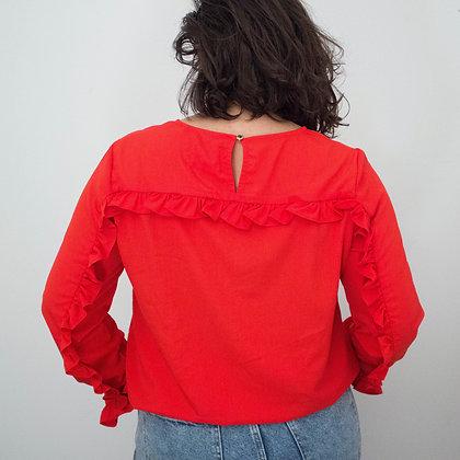 Rdeča bluza z volančki
