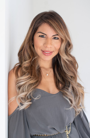 headshot woman business balayage cynthia petfield reveal hair salon curly hair smile studio natural light jo bryan photography rye new york white background professional