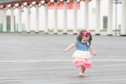 Rye NY New York Jo Bryan JoBryan photo photography photos playland little girl child kid happy walking young pink blue white portrait outside