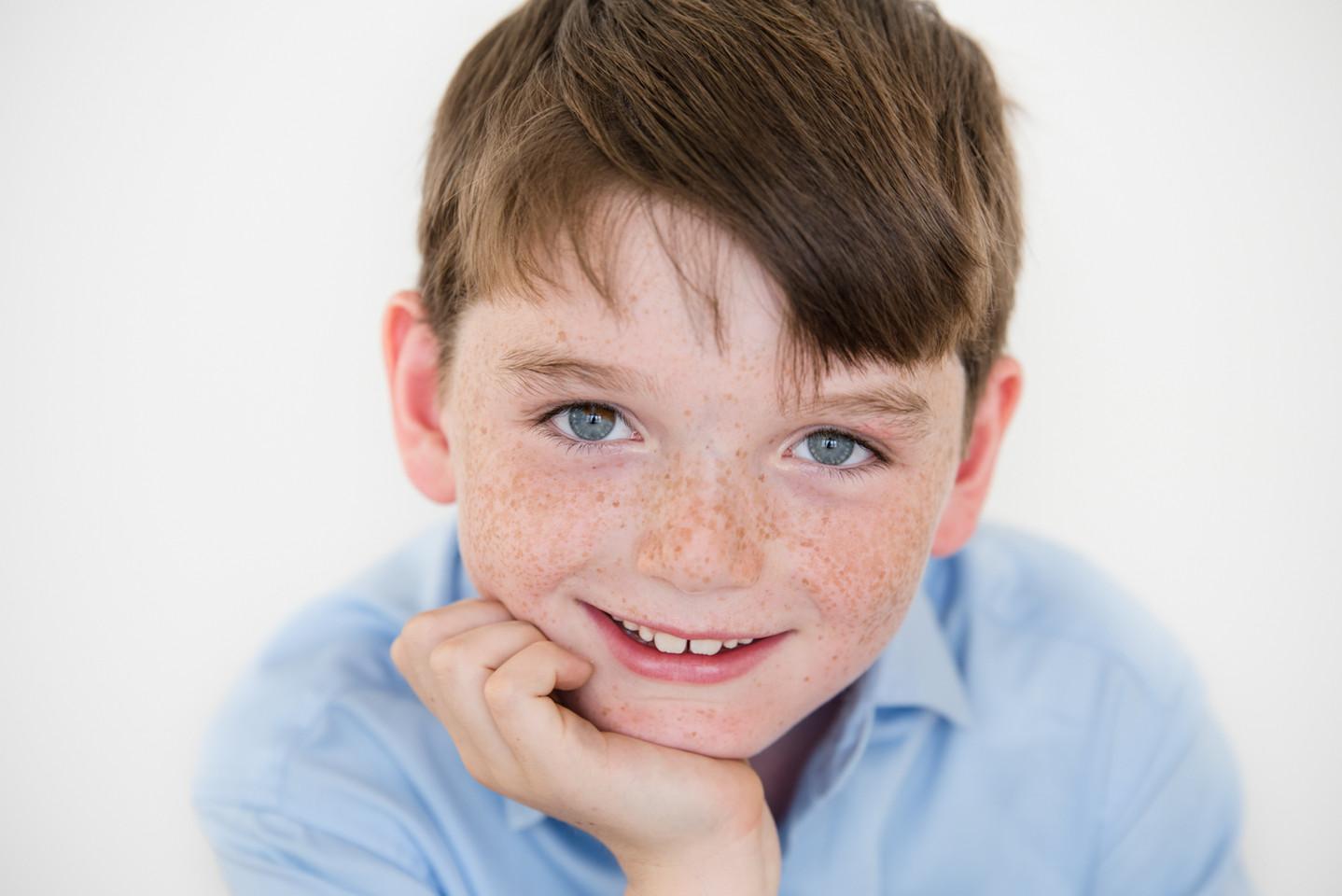Rye NY New York Jo Bryan JoBryan photo photography solo young boy studio natural light blue eyes brown hair blue shirt smiling