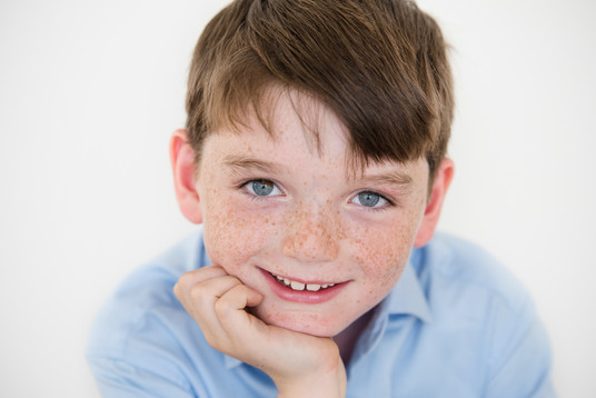 Rye NY New York Jo Bryan JoBryan photo photography solo young boy studio natural light blue eyes brown hair blue shirt smiling