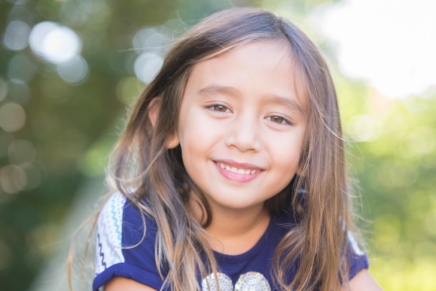 Rye NY New York Jo Bryan JoBryan photo photography solo young girl bokeh blurred background smiling outside