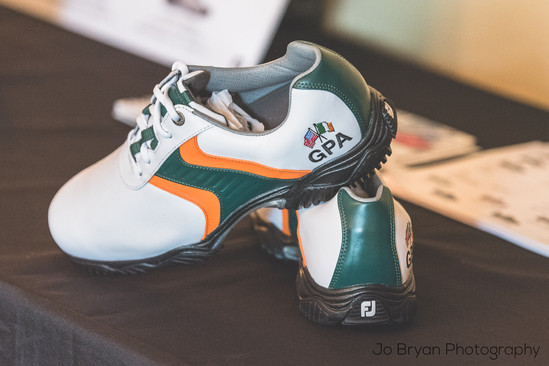 Rye NY New York Jo Bryan JoBryan photo photography photos cleats green white yellow blurred background inside golf