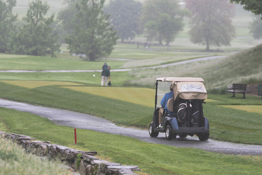 Rye NY New York Jo Bryan JoBryan photo photography photos golf oustide rain happy smiling grass course sports golf cart