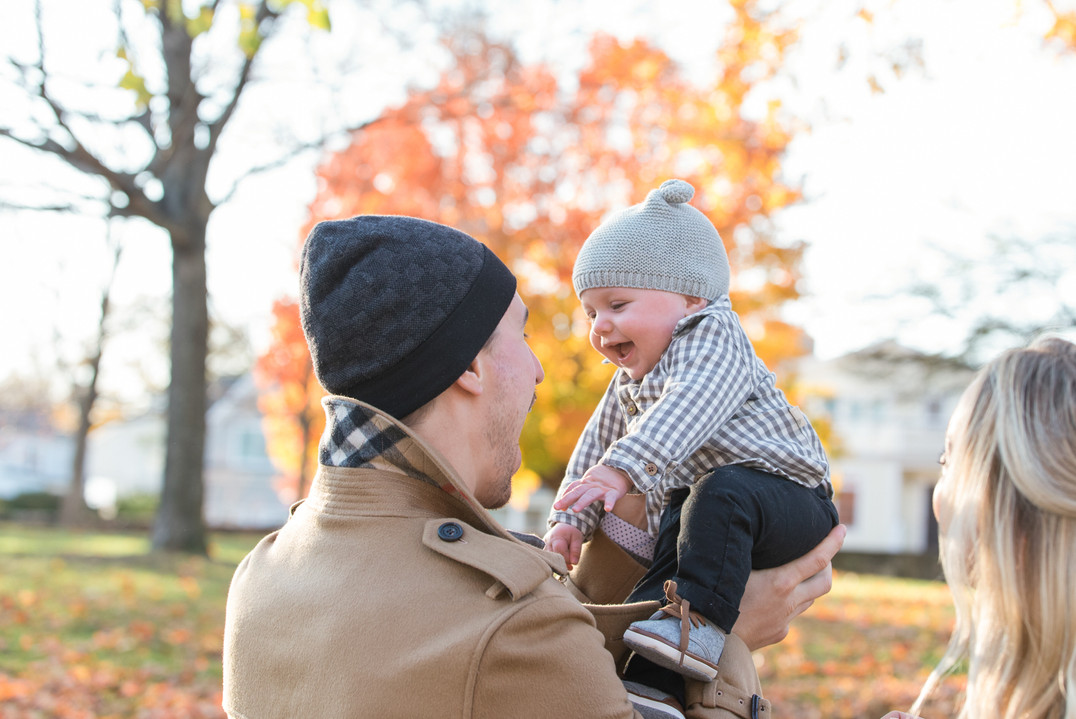 jo bryan photography family photo session outdoors fall colors father son smiling baby rye new york westchester photographer