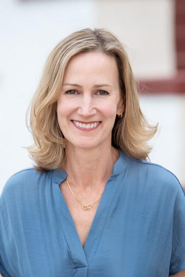 jo bryan photography headshot outdoor bokeh blue shirt blouse smiling blonde hair author annabel monaghan rye new york