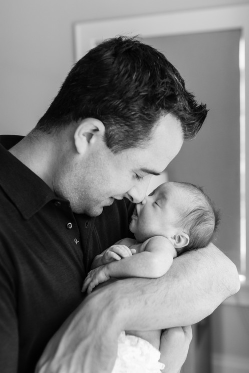jo bryan photography rye new york home newborn session lifestyle natural light dad baby touching noses cuddle family newborn