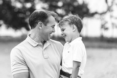 Rye NY New York Jo Bryan JoBryan photo photography photos black and white BW B&W father son young outside portrait happy smiling blurred background boy