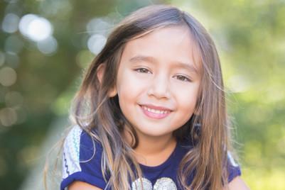 Rye NY New York Jo Bryan JoBryan young girl outside blurred background smiling portrait headshot