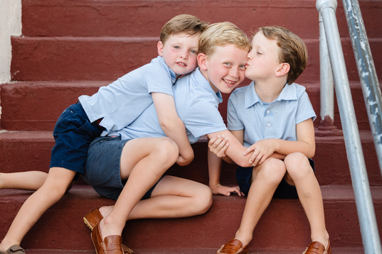 jo bryan photography family photo session outdoors boys brothers siblings cuddle playland steps blue striped shirt brown shoes outdoor rye new york westchester photographer