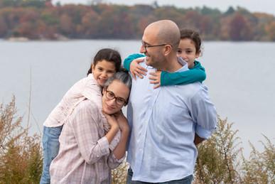 Rye NY New York Jo Bryan JoBryan photo photography family cuddle edith read sanctuary rye new york hugging water fall weather