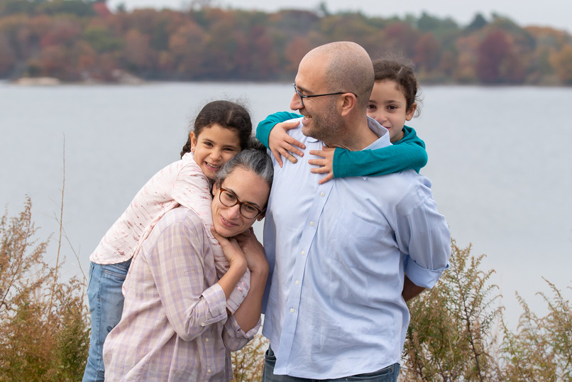 Rye NY New York Jo Bryan JoBryan photo photography family cuddle edith read sanctuary rye new york hugging water fall weather