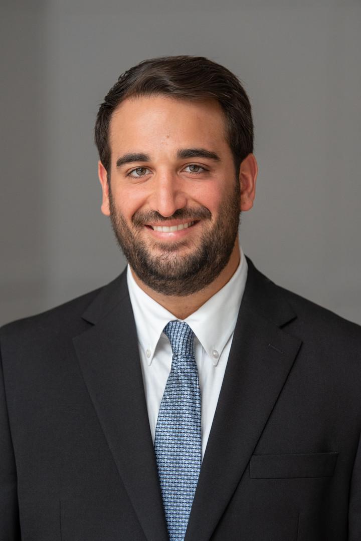 headshot man business suit tie beard dark hair smile natural light jo bryan photography rye new york grey background professional