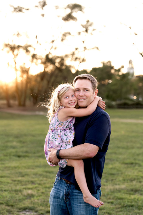 jo bryan photography family photo session outdoors park  beach outdoor father daughter girl cuddle rye new york westchester photograher