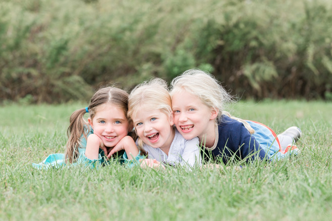 jo bryan photography family photo session outdoors park beach outdoor girls sisters smiling grass rye new york westchester photograher