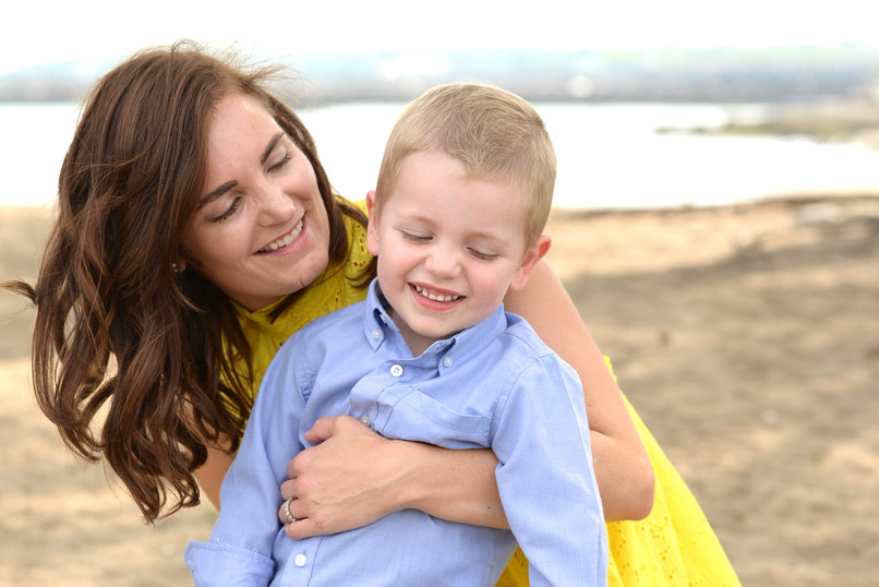 jo bryan photography family photo session outdoors park beach outdoor sunset golden hour hug rye new york westchester photograher mother son sand yellow dress blue shirt
