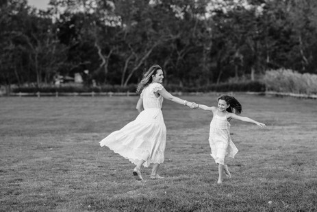 jo bryan photography dancing mom mother daughter flowy dresses grass park beach sunset photo session family happy