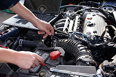 16279192-car-mechanic-working-in-auto-re