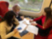 Students studying on the train.