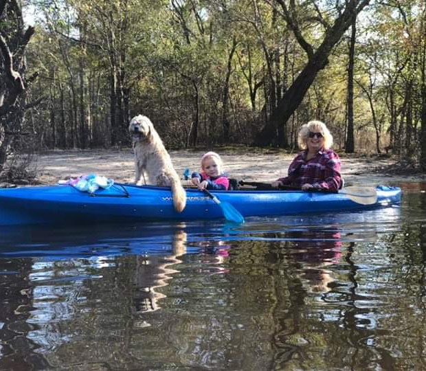 Lucy, Cathy and family on the river