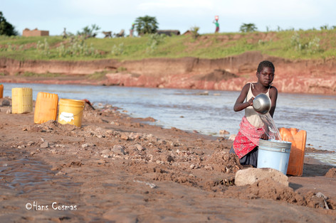 Girl fetching water for drinking and cooking