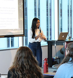 Abarna giving a presentation at an Ally Squared event