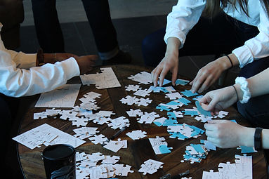 A group of hands participating in a puzzle