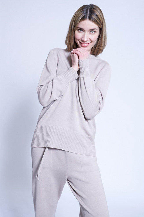Sweater with rounded hem in many colors