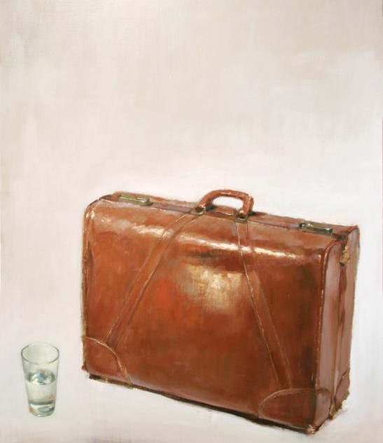 Suitcase with water glass