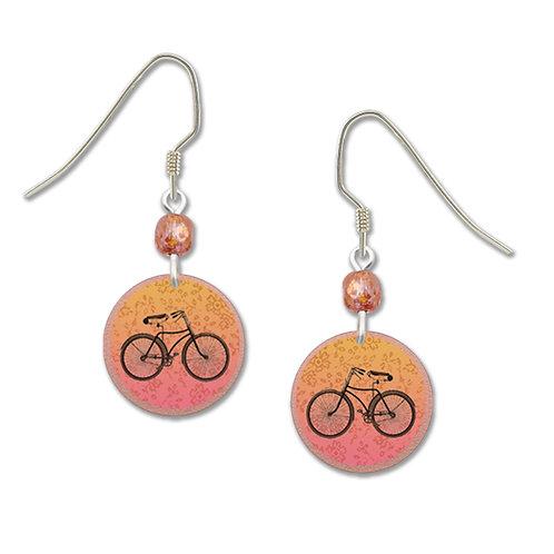 Orange and pink circle with bike