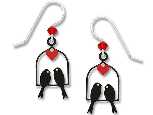 Two birds on a swing with red heart