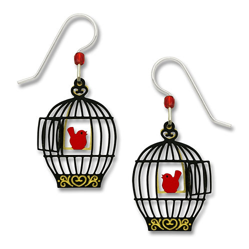 Open bird cage with red bird on swing