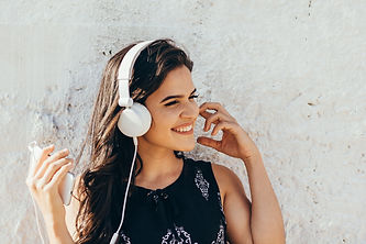 Young woman listening to music via headp
