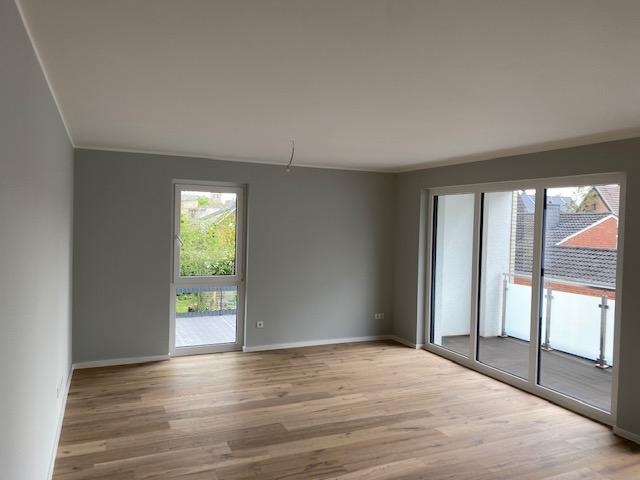 Wohnzimmer mit Ausgang zur Terrasse.png