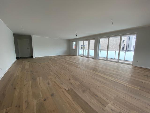 Wohnzimmer mit offener Küche.png