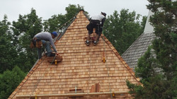 Action shot roofing installation