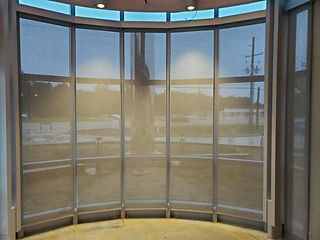 roller shades in a curved window .jpg