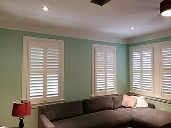 shutters with teal wall.webp