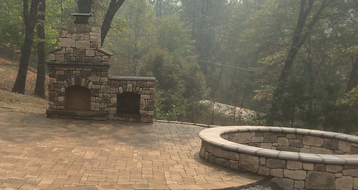 Paver patio with outdoor fireplace and f
