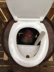 Jez Hastings leads the compost toilet construction... from beneath (2017