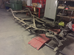 The Cadillac frame before metal shot