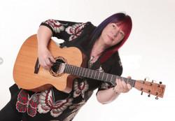 1646mod Jo with guitar