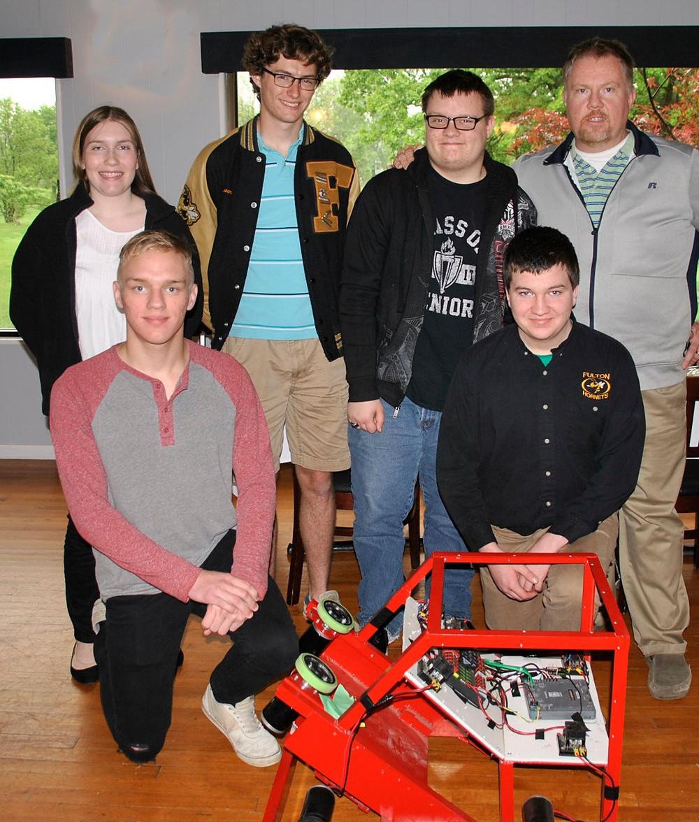 The FHS Robotics Team shows off their robot.