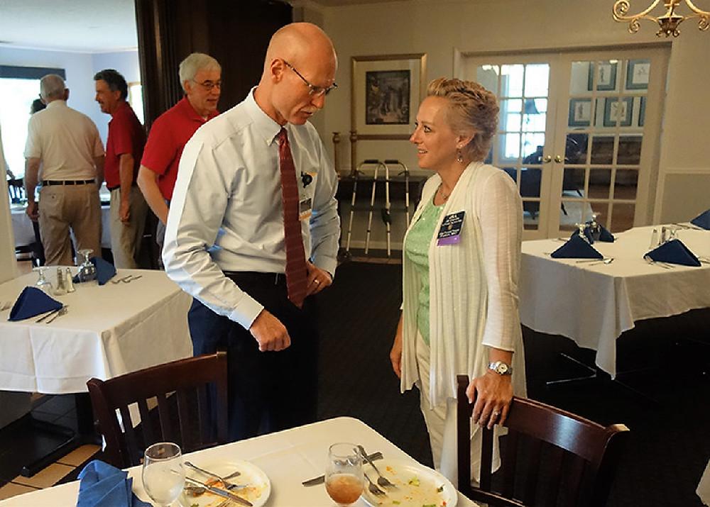 Dr. Daniel Slawski (left) talks to Jill Gamlin, of Atlas Physical Therapy.