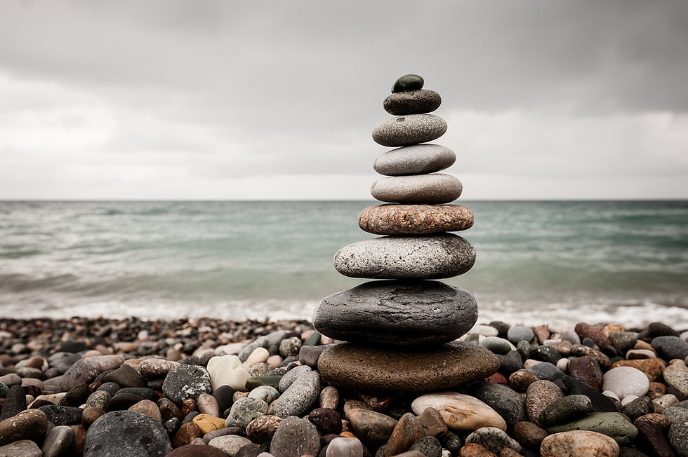 pebble tower cairn on a beach