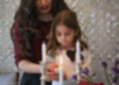 lighing shabat candle