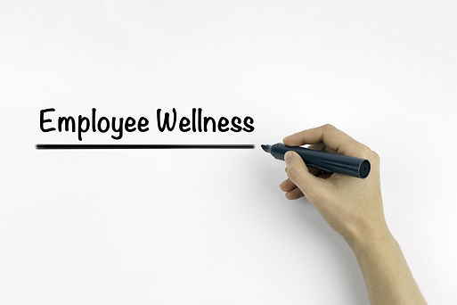 Hand with marker writing: Employee Welln